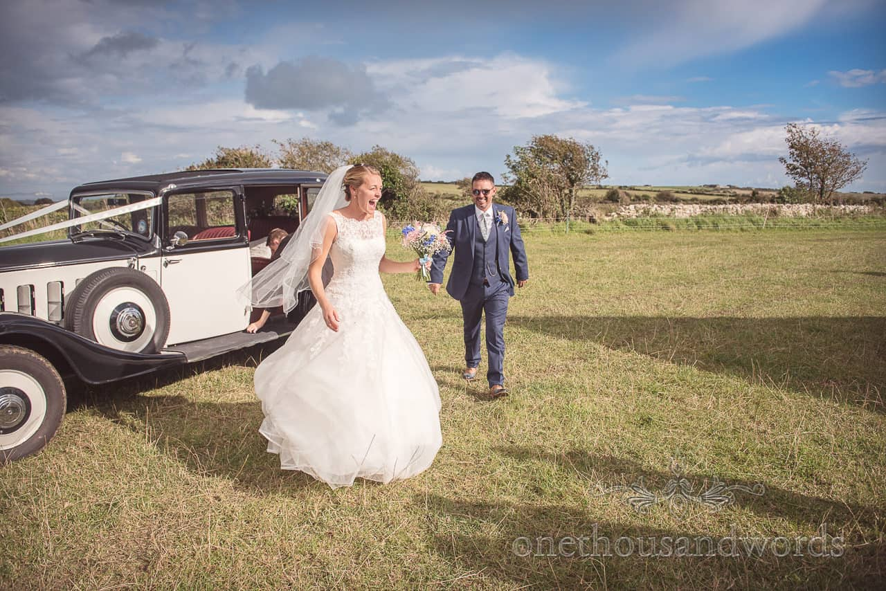 Bride and groom arrive at Dorset Wedding Photographers Wedding reception venue