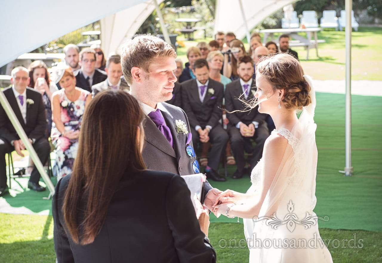 Bride and groom during clifftop garden ceremony at Grand Hotel Wedding Photographs