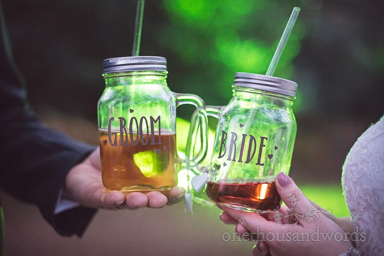 Bride and groom masonry jar drinking glasses with straws