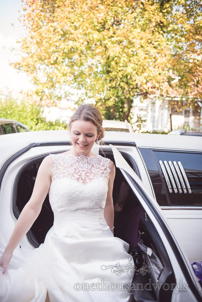 Bride exits wedding limo at Grand Hotel Wedding Photographs