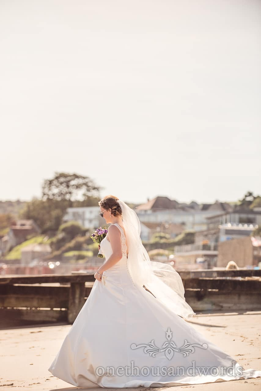 Bride in sunshine on Swanage beach from Grand Hotel Wedding Photographs