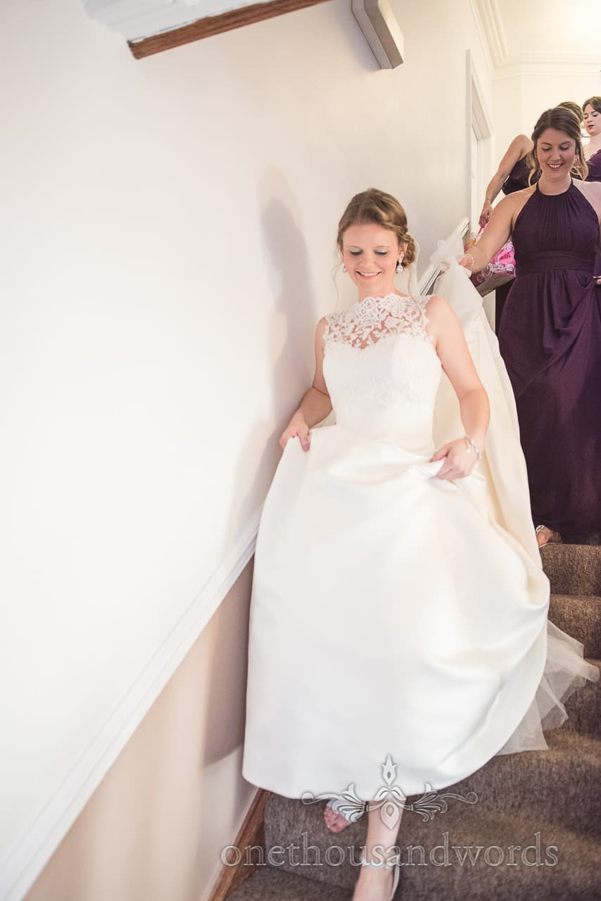 Bride leads bridesmaid down the stairs from Grand Hotel Wedding Photographs