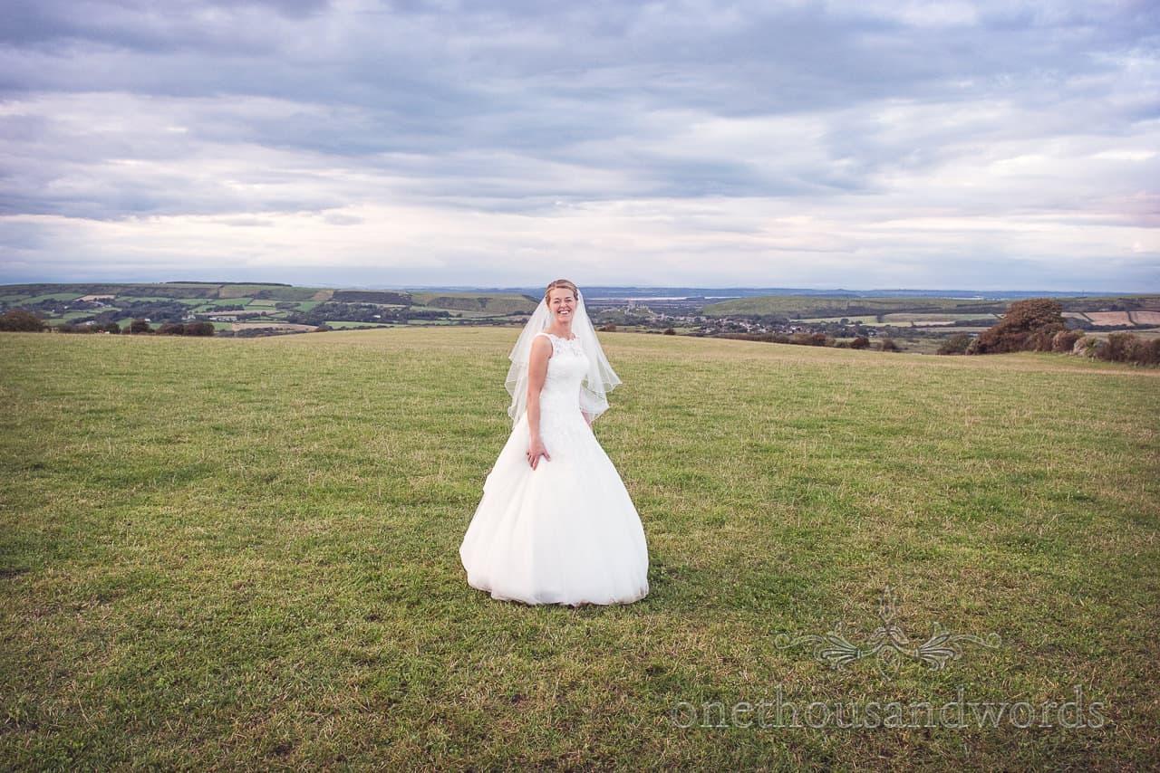 Bride with Dorset countryside at Dorset Wedding Photographers Wedding