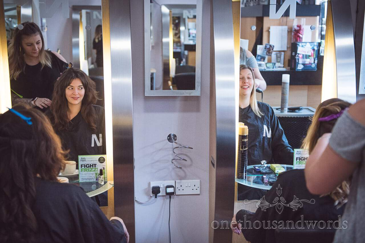Bridesmaid have hair styled on morning of Grand Hotel Wedding Photographs