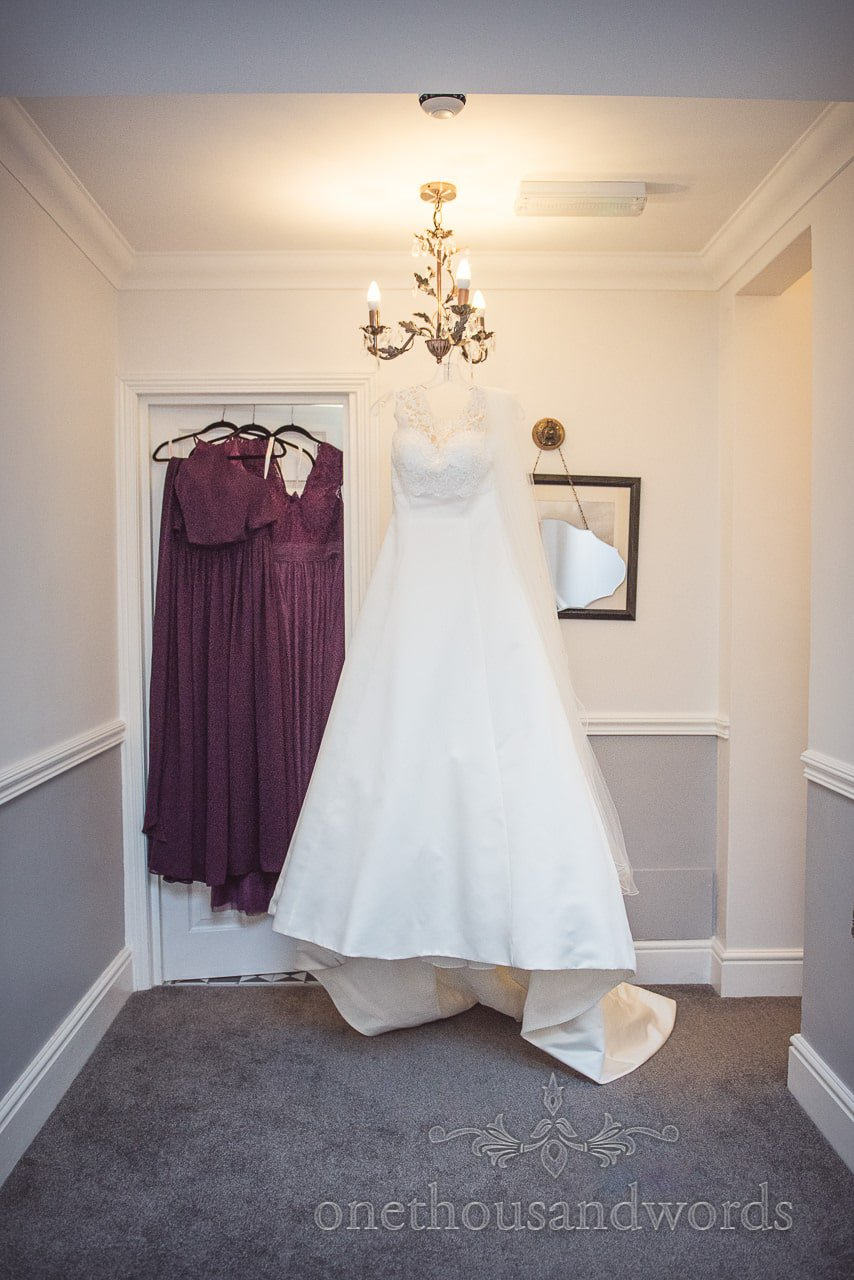 Bridesmaids and wedding dress hang in hallway from Grand Hotel Wedding Photographs