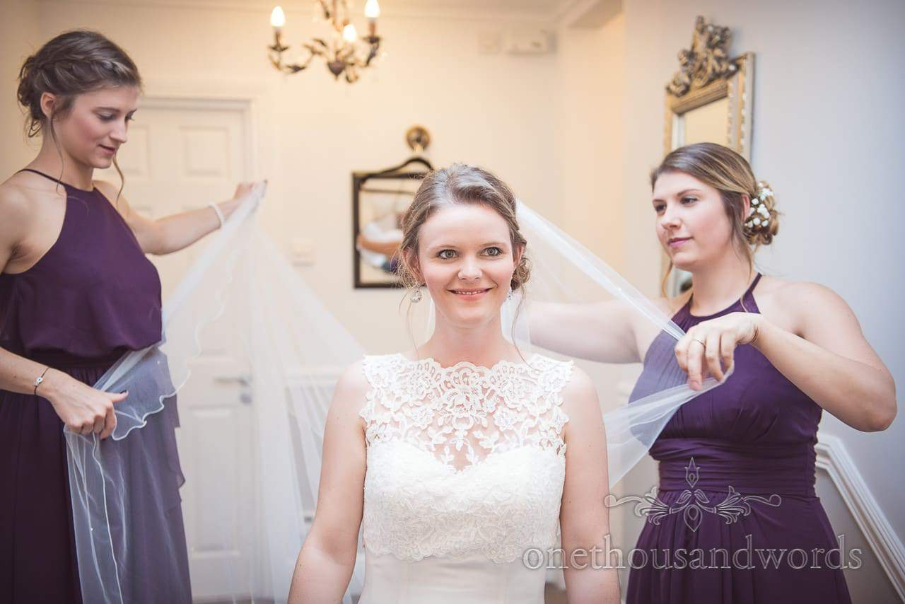 Bridesmaids help bride with veil on morning of Grand Hotel Wedding Photographs