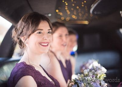 Bridesmaids inside limousine wedding car at Grand Hotel Wedding Photographs