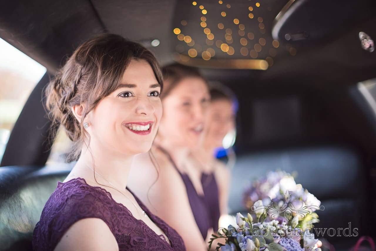 Bridesmaids inside limousine wedding car at Grand Hotel Wedding Photographs
