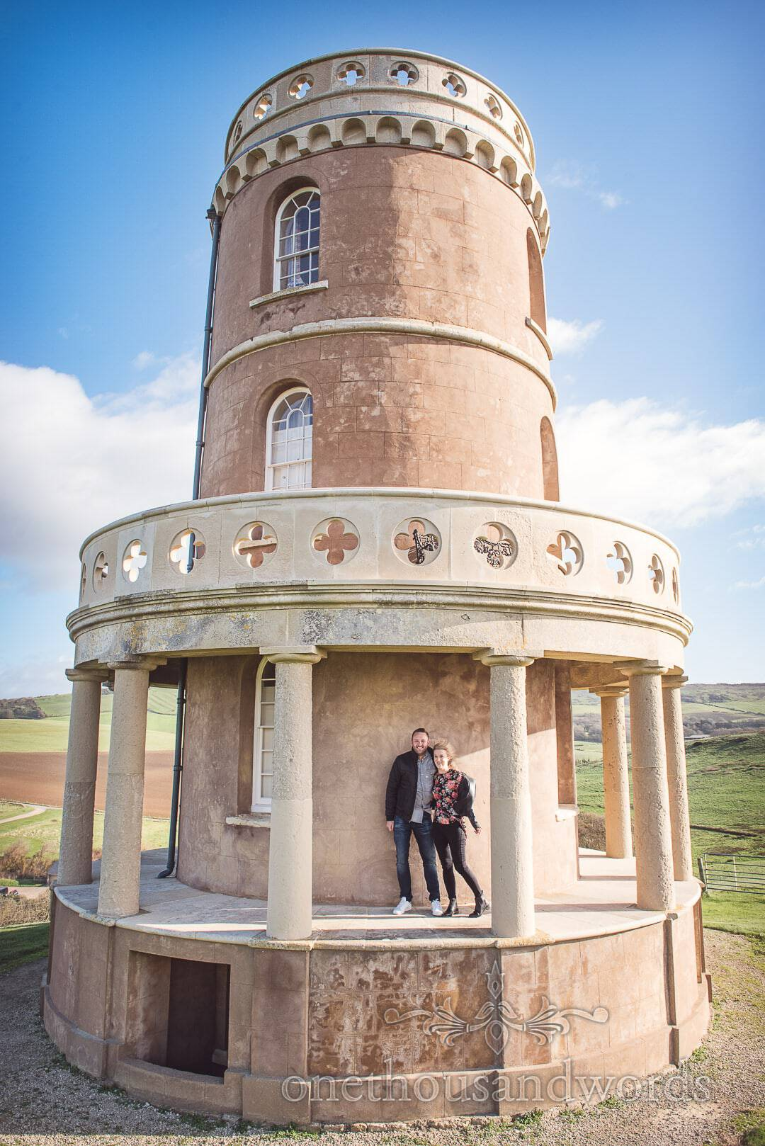 Couple at cliff top tower from Kimmeridge Bay Engagement Photographs