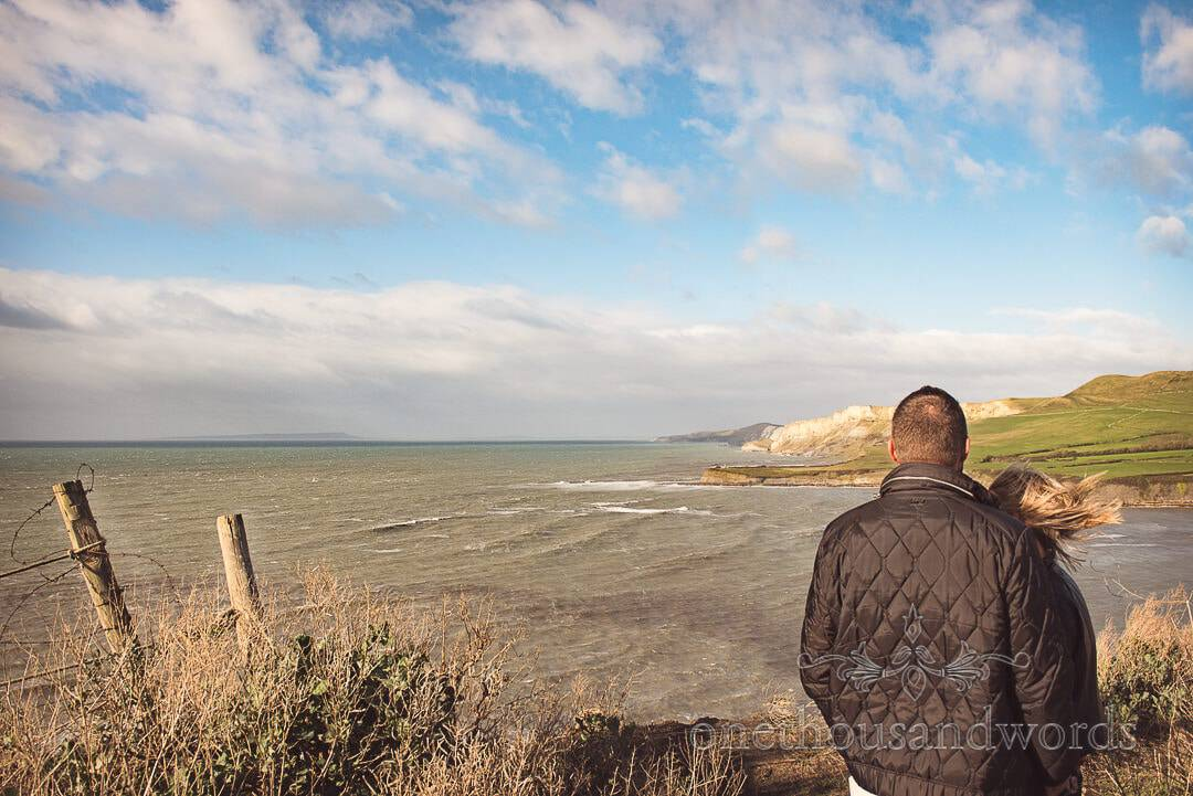 Couple look down the Jurassic coastline from Kimmeridge Bay Engagement Photographs