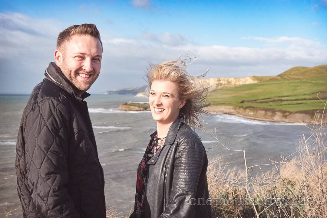 Couple on cliff top above Kimmeridge Bay Engagement Photographs