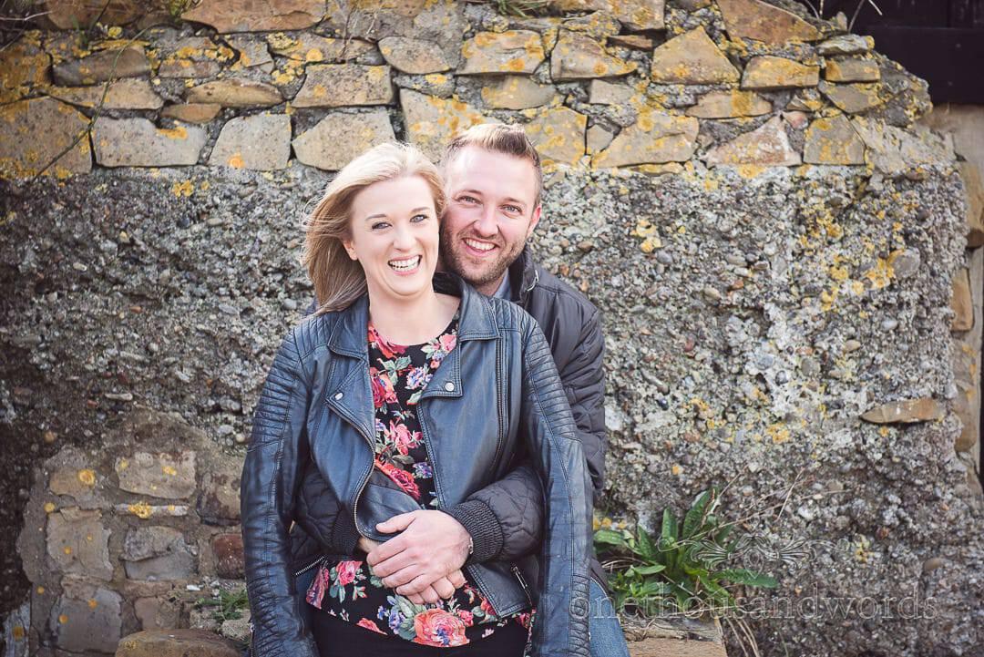 Couple share a joke at at Kimmeridge Bay Engagement Photographs