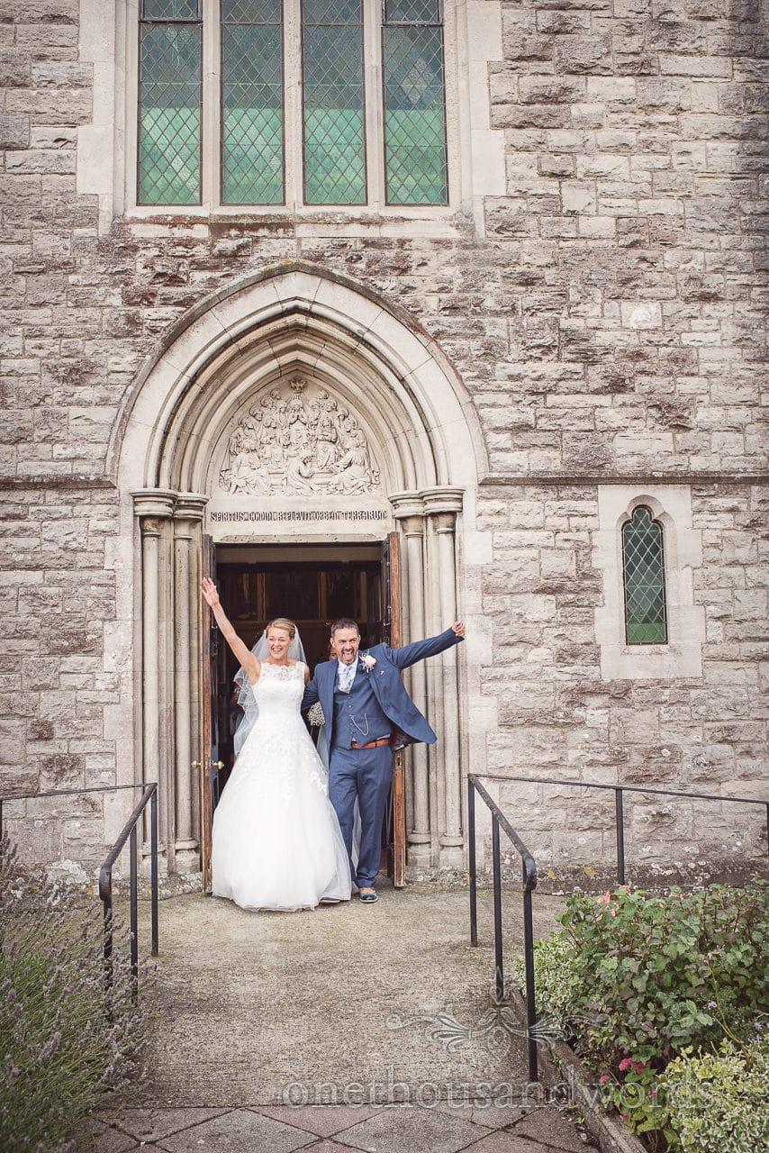 Dorset Wedding Photographer exits church wedding ceremony celebrates with bride