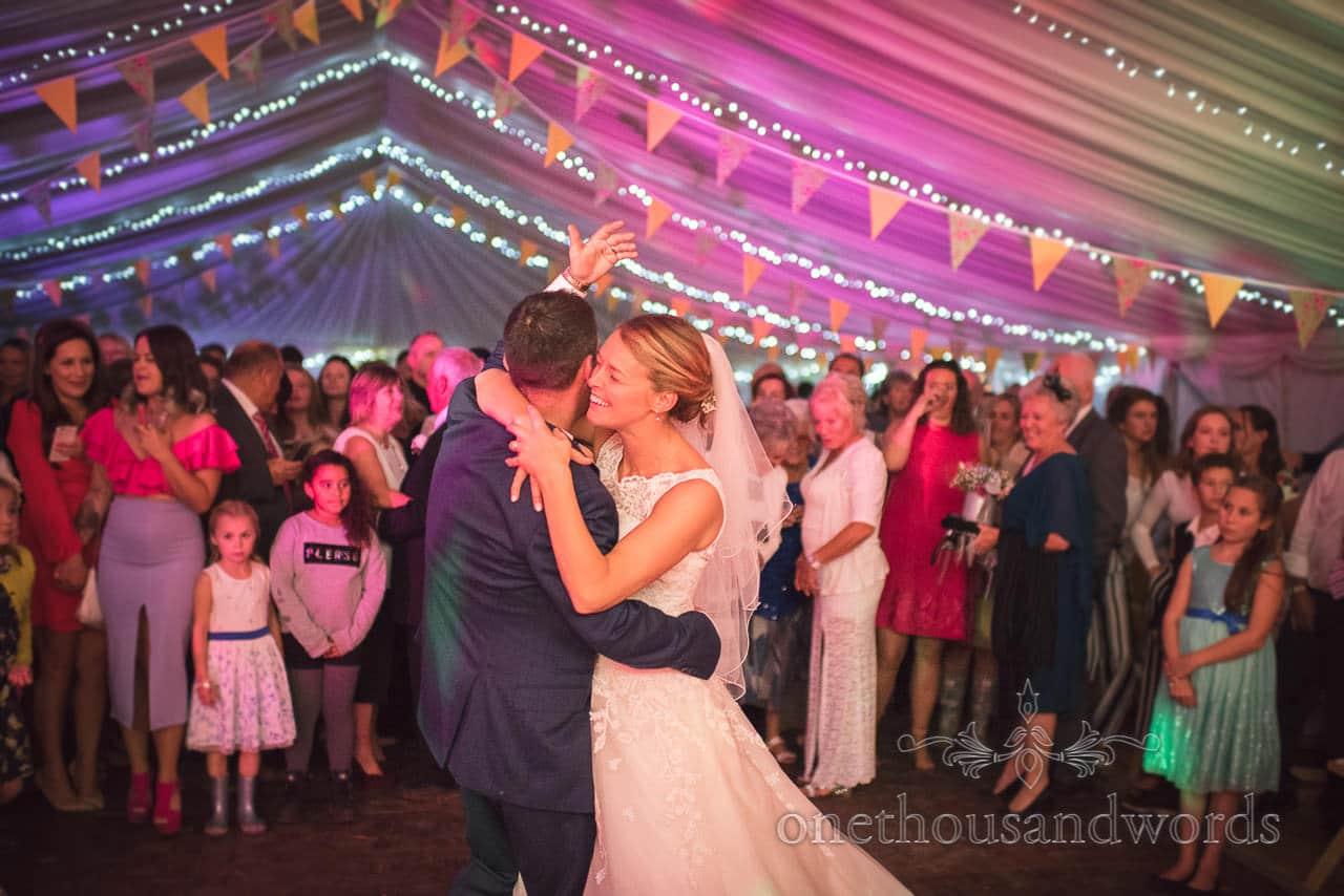 Dorset Wedding Photographer groom calls guests onto marquee dancefloor
