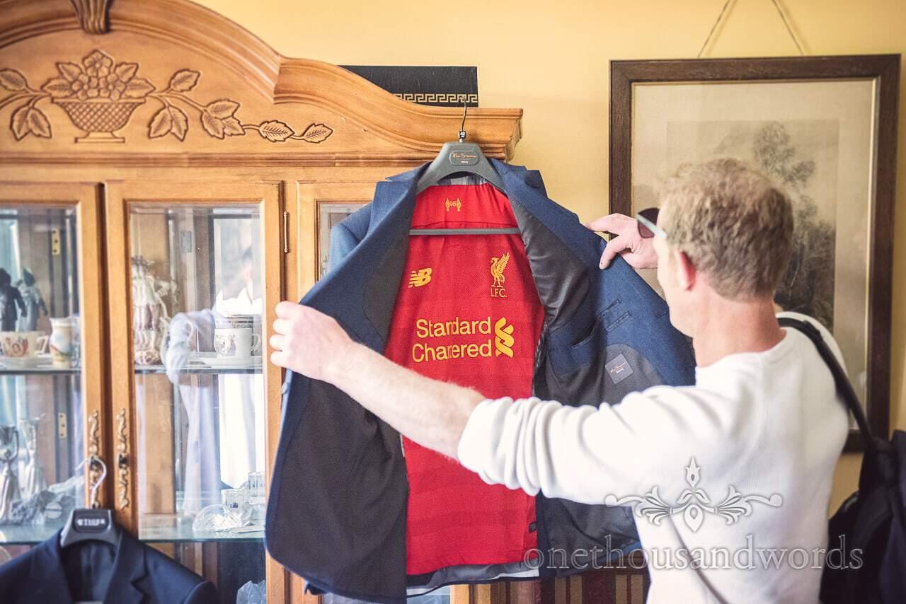 Dorset Wedding Photographer has Liverpool FC kit sewn into lining of suit jacket