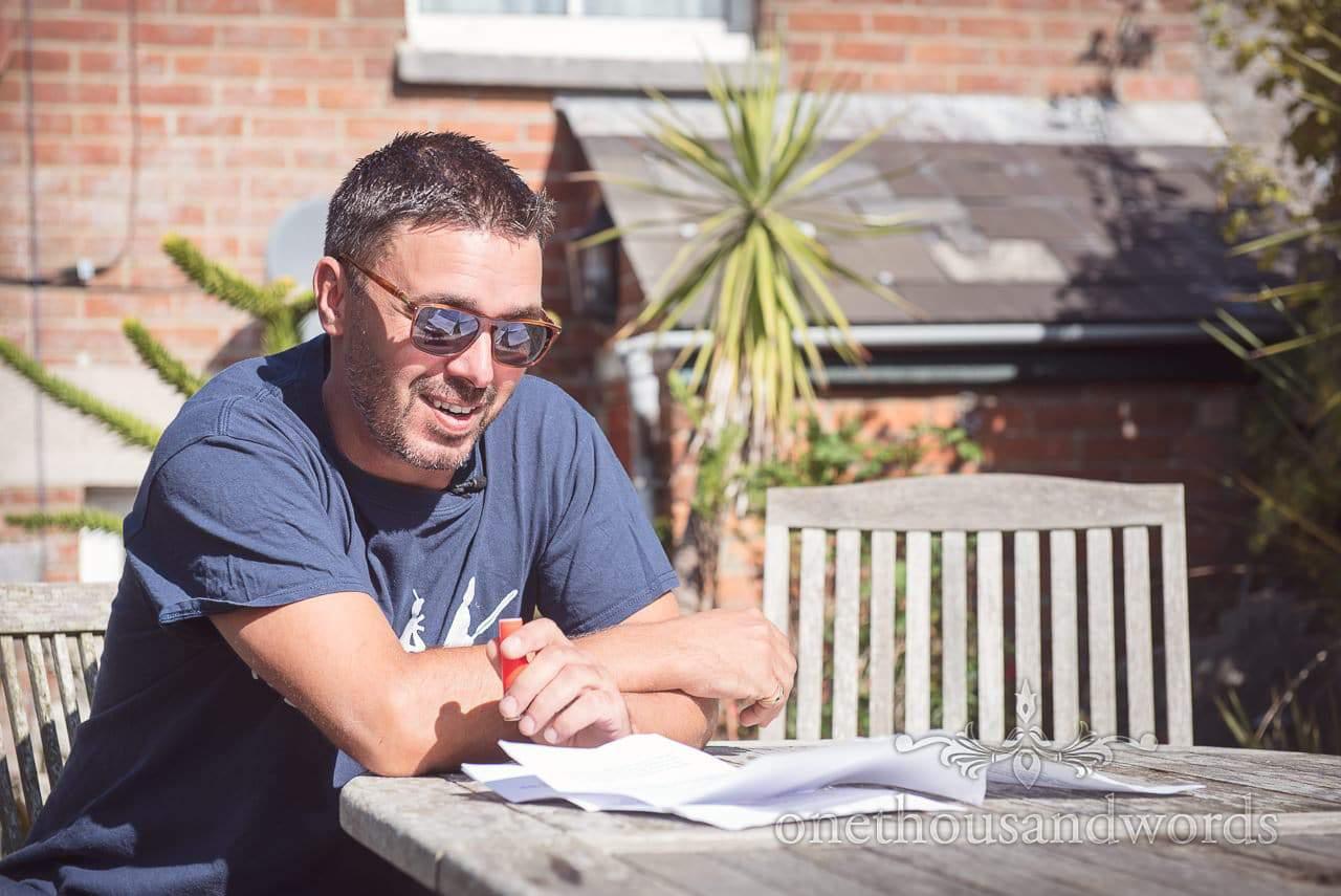 Dorset Wedding Photographer practices grooms speech on wedding morning