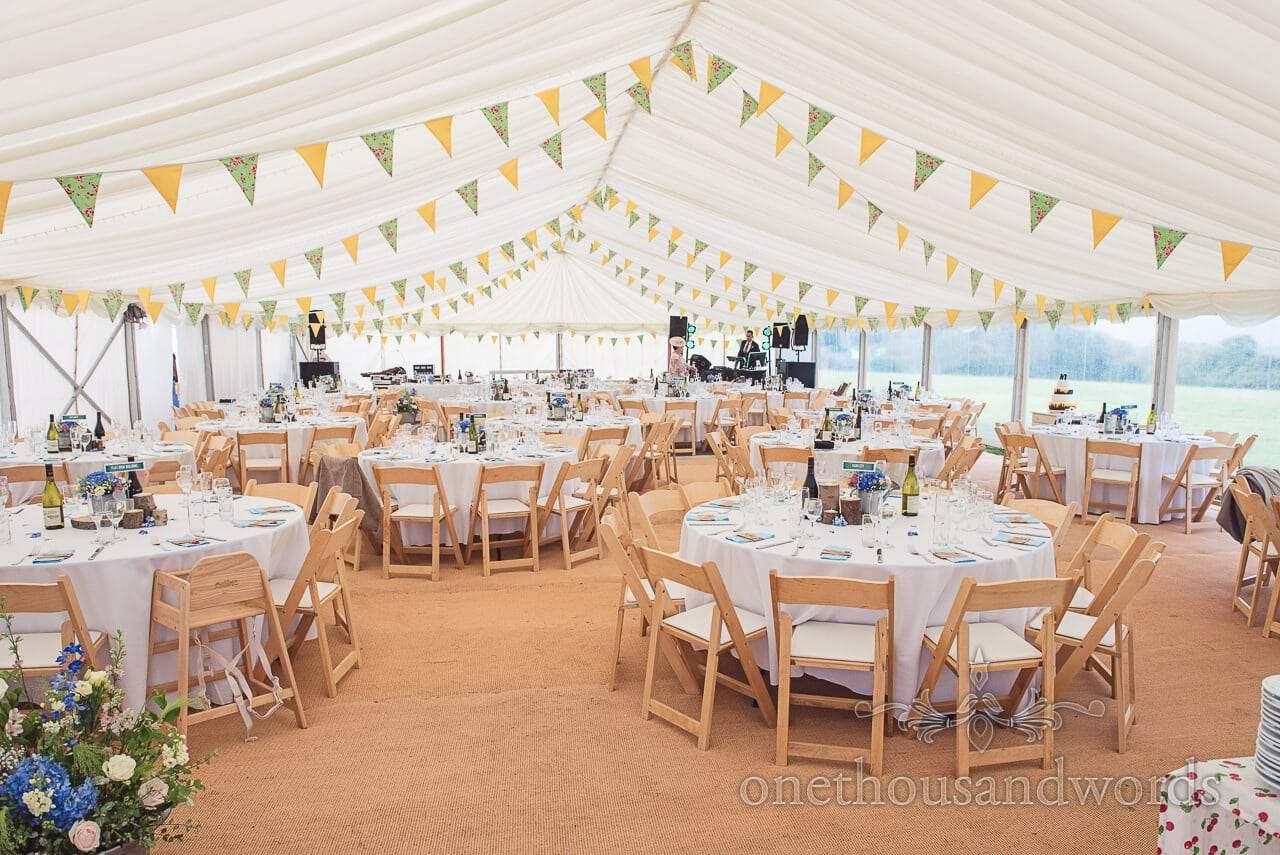 Dorset Wedding Photographer's large Wedding Marquee setup with bunting