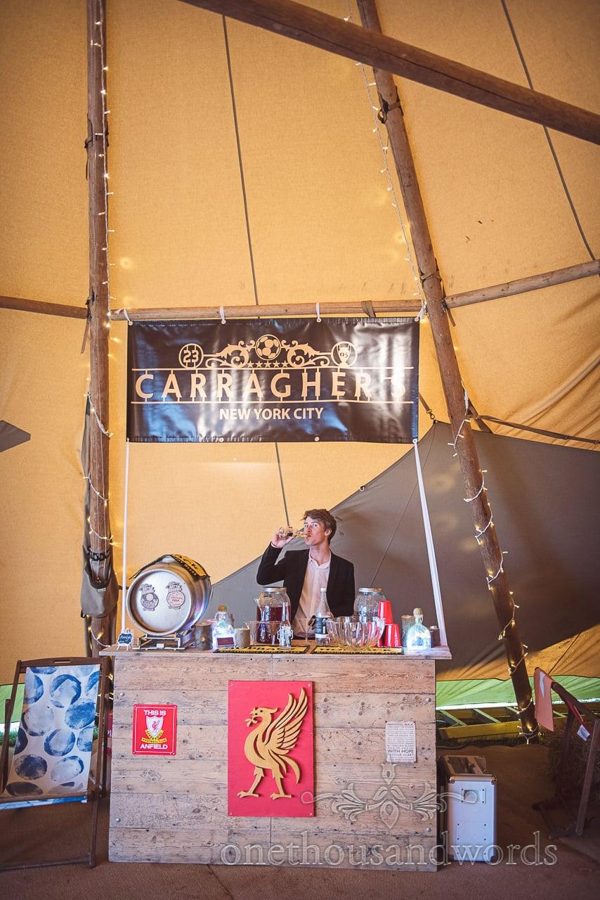 Dorset Wedding Photographer's Liverpool FC themed bar in Wedding tipi in Dorset