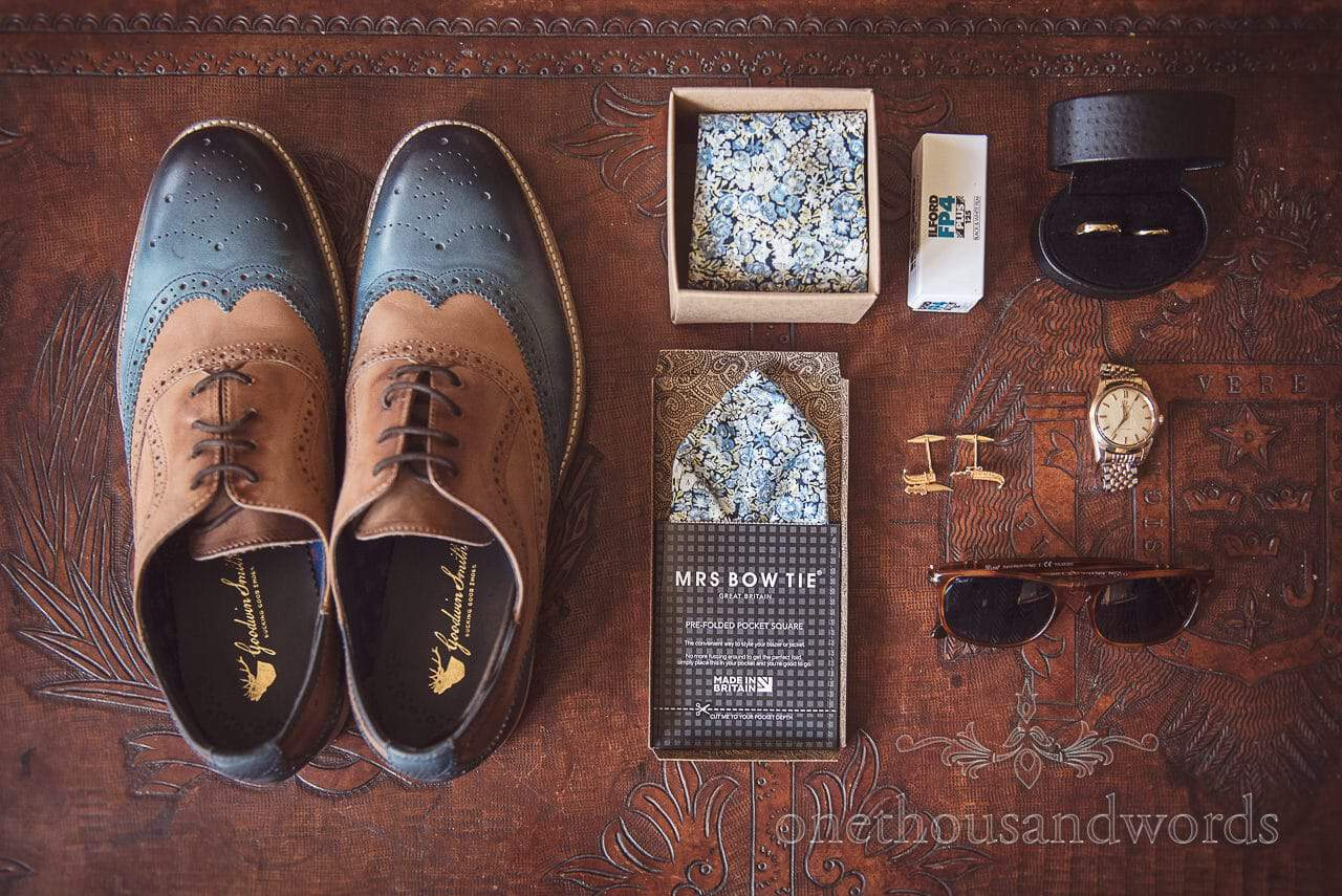 Dorset Wedding Photographer's shoes and wedding accessories on leather table