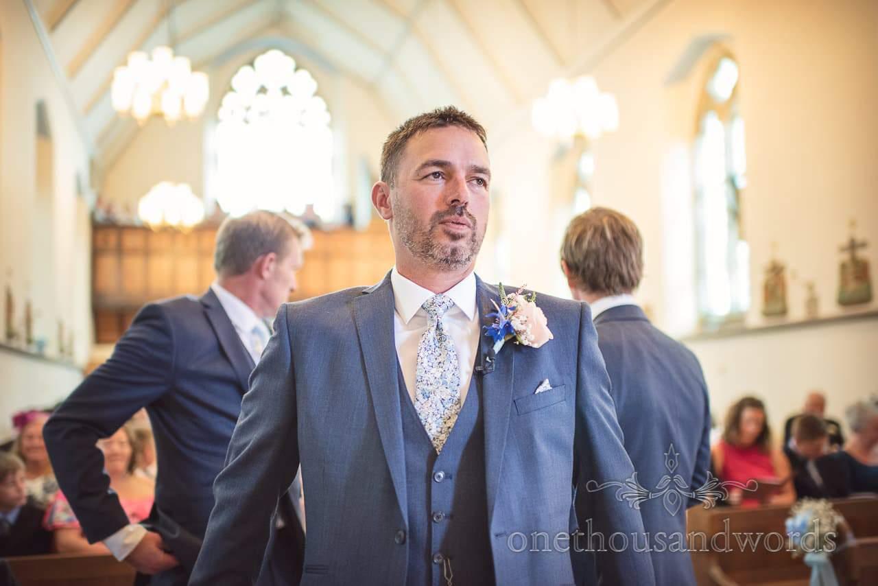 Dorset Wedding Photographer takes a deep breath in church before wedding ceremony