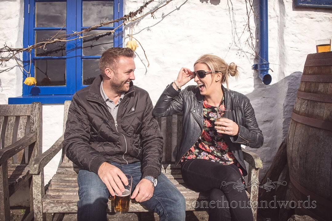Engaged couple outside pub from Kimmeridge Bay engagement Photographs