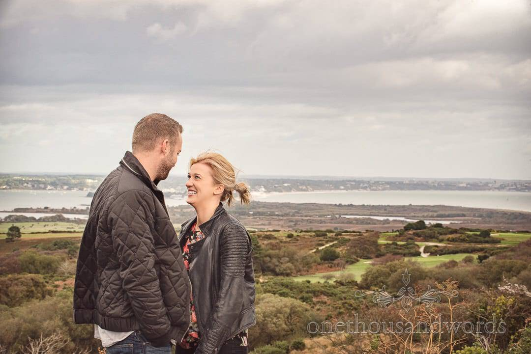 Engagement couple at Dorset view point overlooking Poole harbour