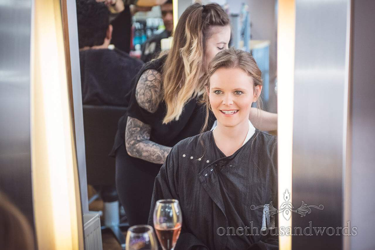 Excited bride in mirror has hair styled before Grand Hotel Wedding Photographs