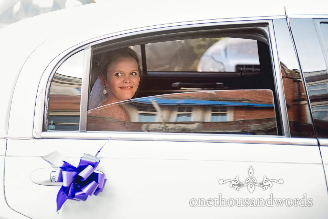 Excited bride through limo window at Grand Hotel Wedding Photographs