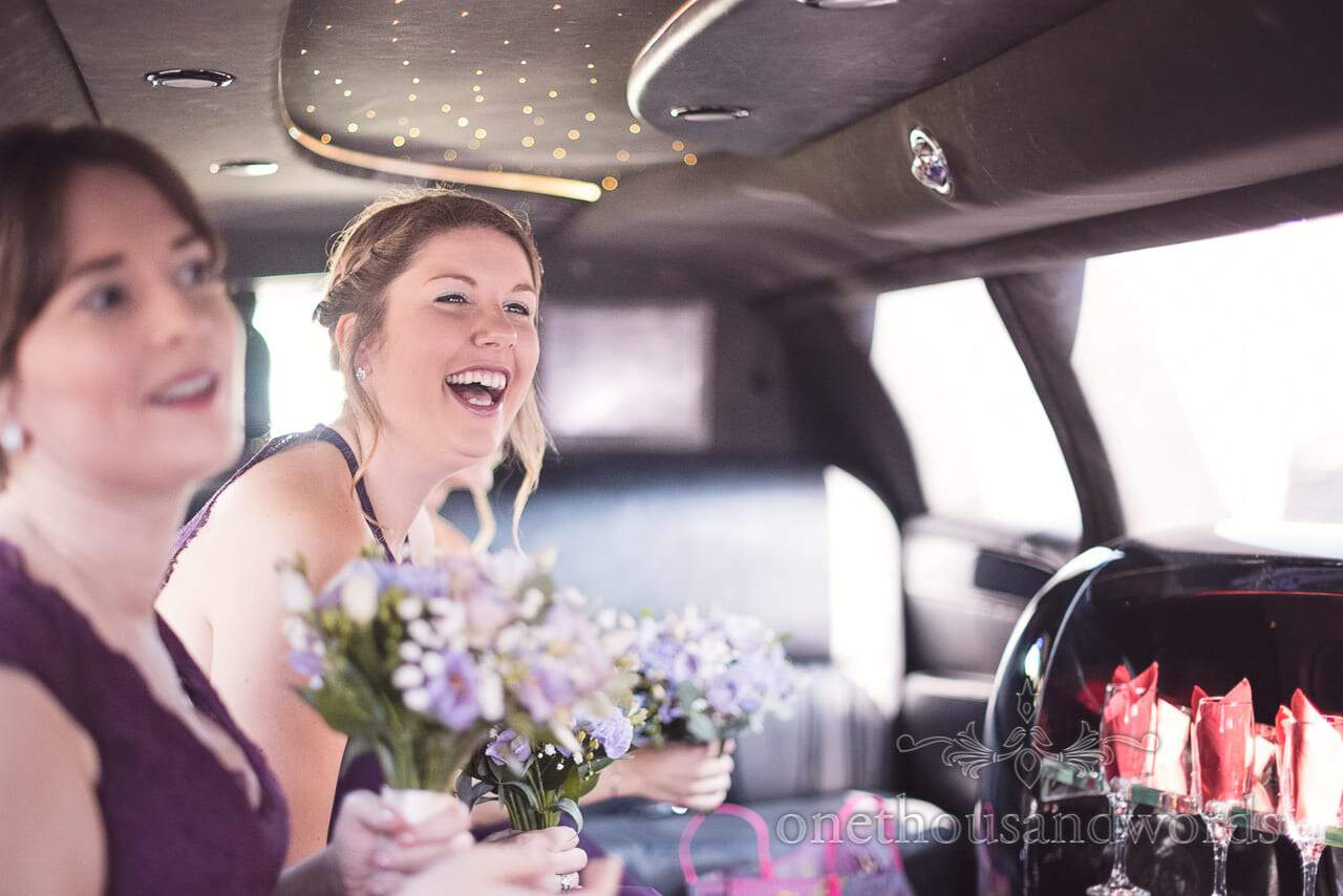 Excited bridesmaid inside wedding car from Grand Hotel Wedding Photographs