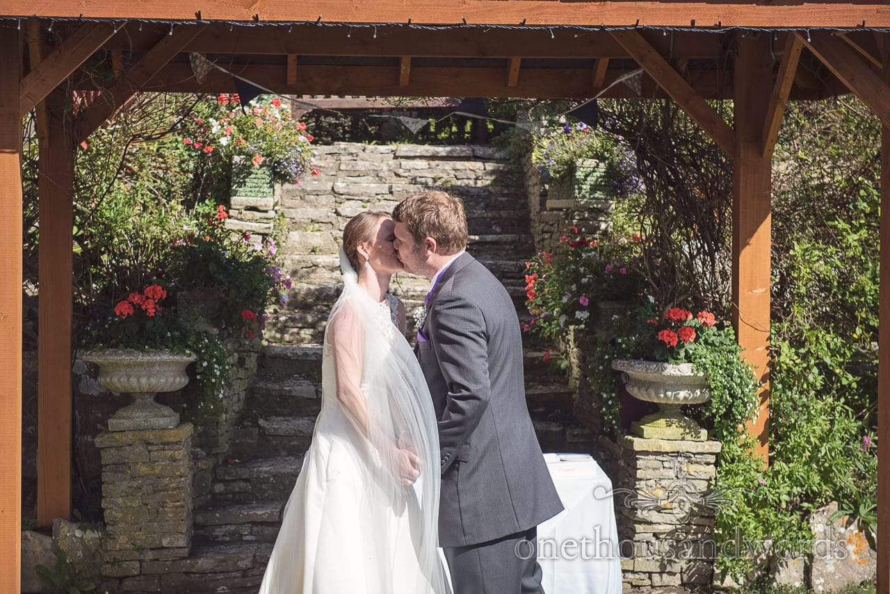 First kiss after clifftop garden ceremony at Grand Hotel Wedding Photographs