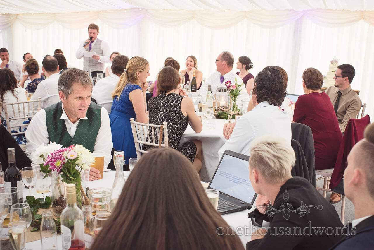 Foreign family have wedding speeches translated for them on laptop screens