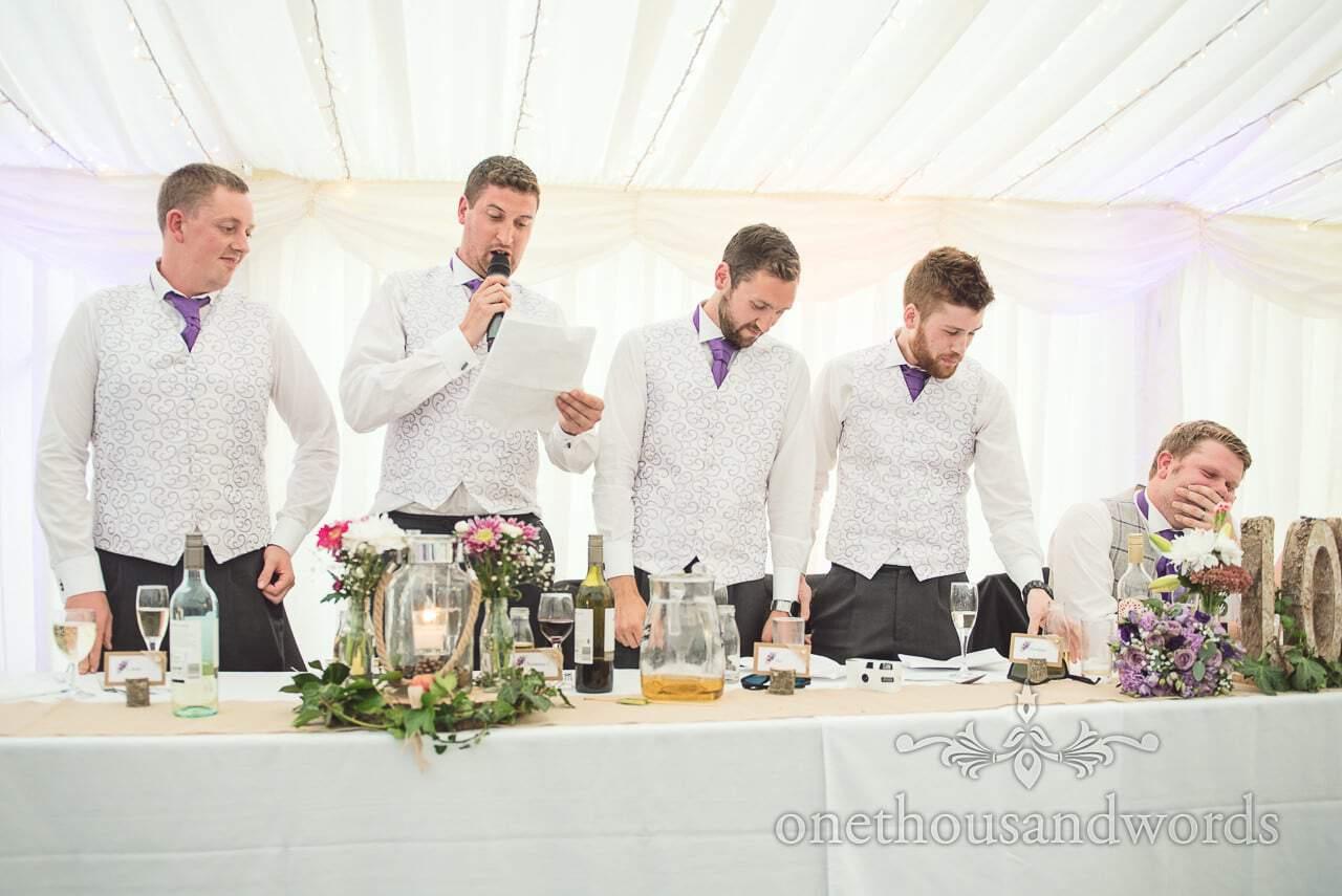 Four best men deliver wedding speeches at marquee wedding in Dorset