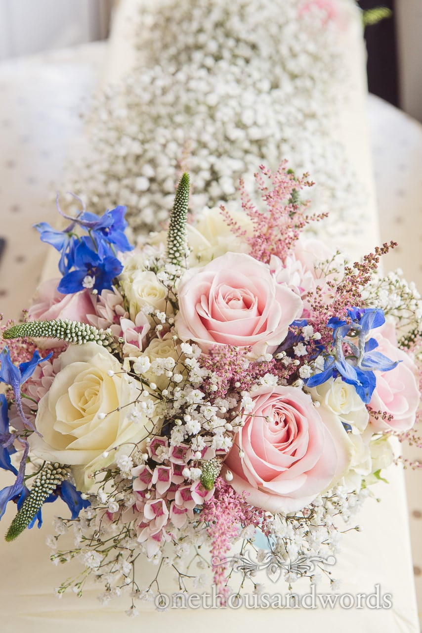 Gorgeous pastel countryside flowers wedding bouquet with pink and cream roses