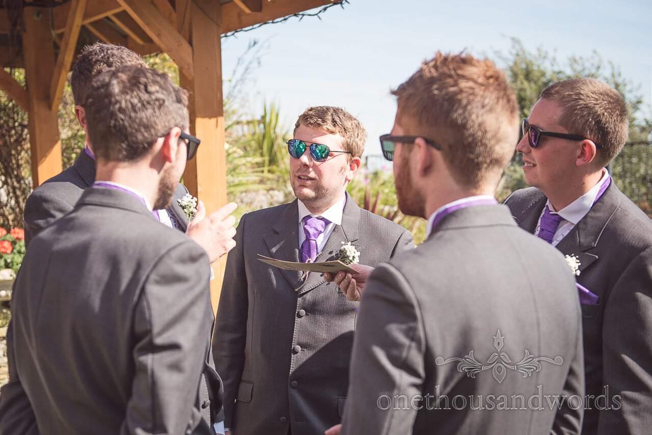 Groom and groomsmen in clifftop garden before Grand Hotel Wedding Photographs