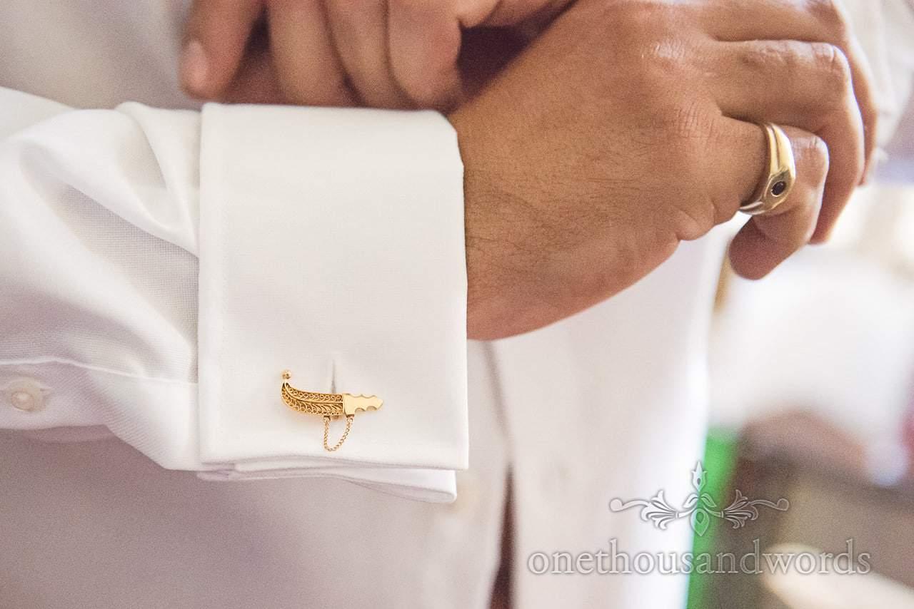Grooms golden sword cufflinks from Dorset Wedding Photographers Wedding Photos