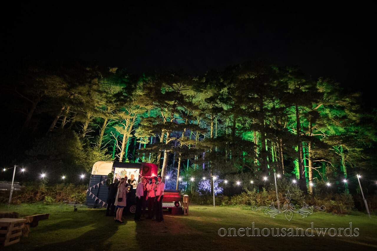 Guests gather outside the horsebox bar at Burnbake wedding reception