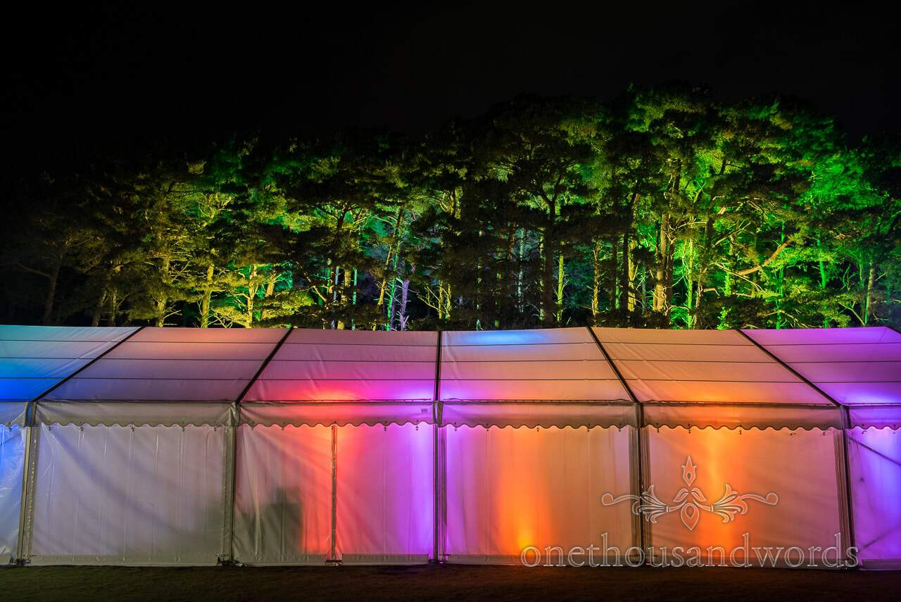 Illuminated marquee and trees from Burnbake wedding reception
