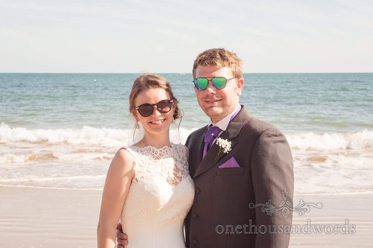 New Mr and Mrs don sunglasses on beach from Grand Hotel Wedding Photographs