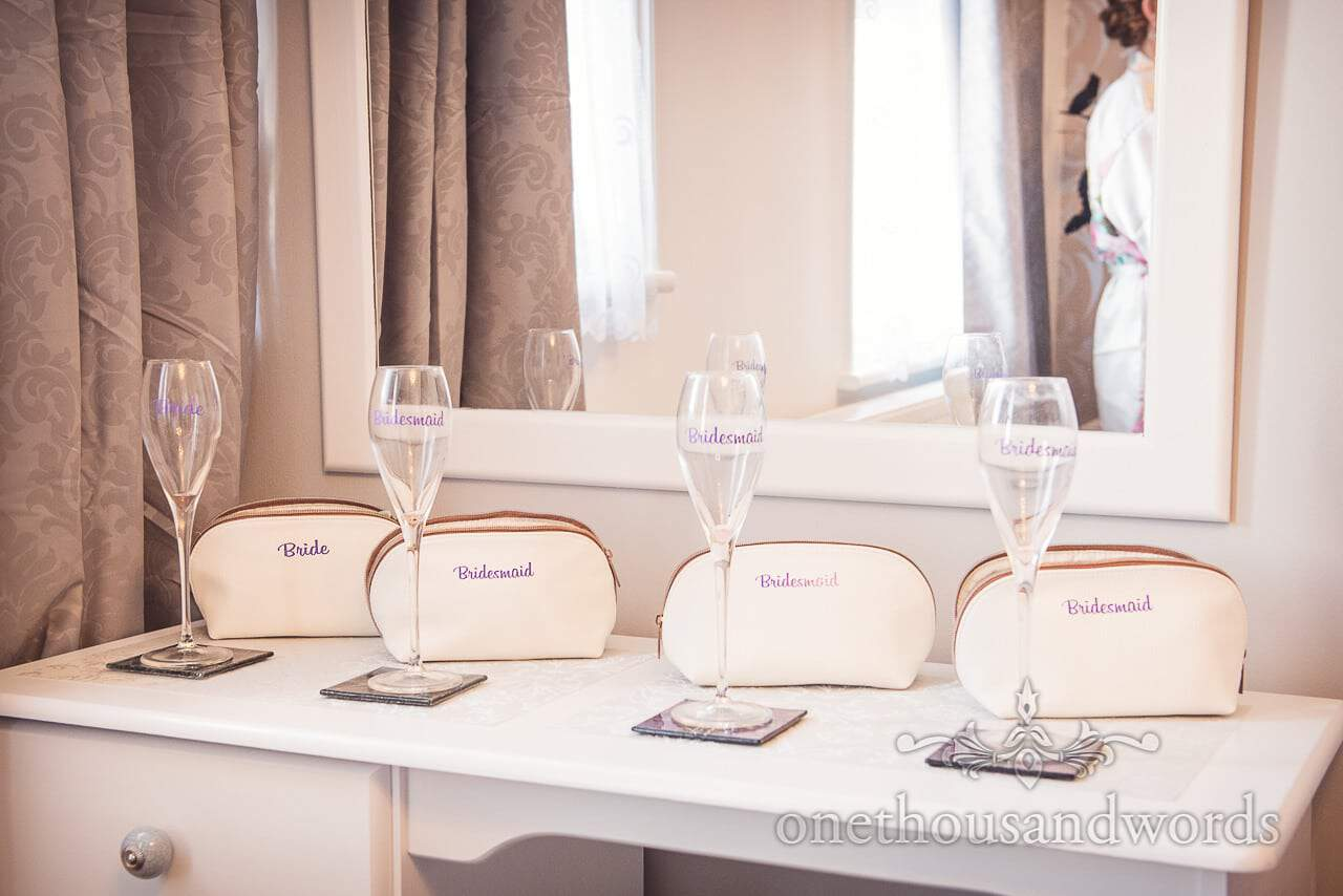 Personalised champagne flutes and make up bags from Grand Hotel Wedding Photographs