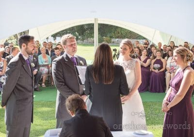Registrar conducts civil ceremony in clifftop garden at Grand Hotel Wedding Photographs