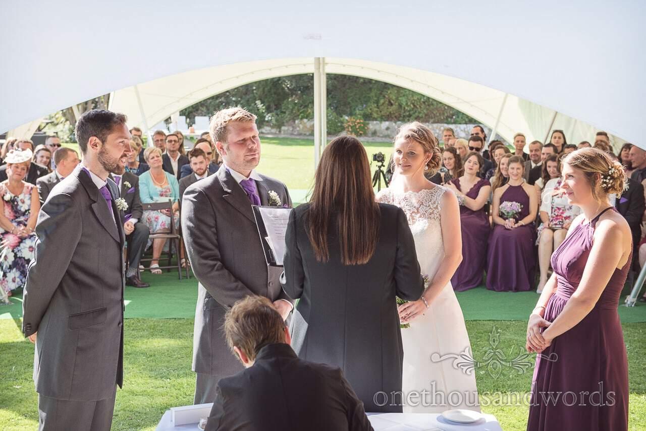 Registrar conducts civil ceremony in clifftop garden at Grand Hotel Wedding Photographs