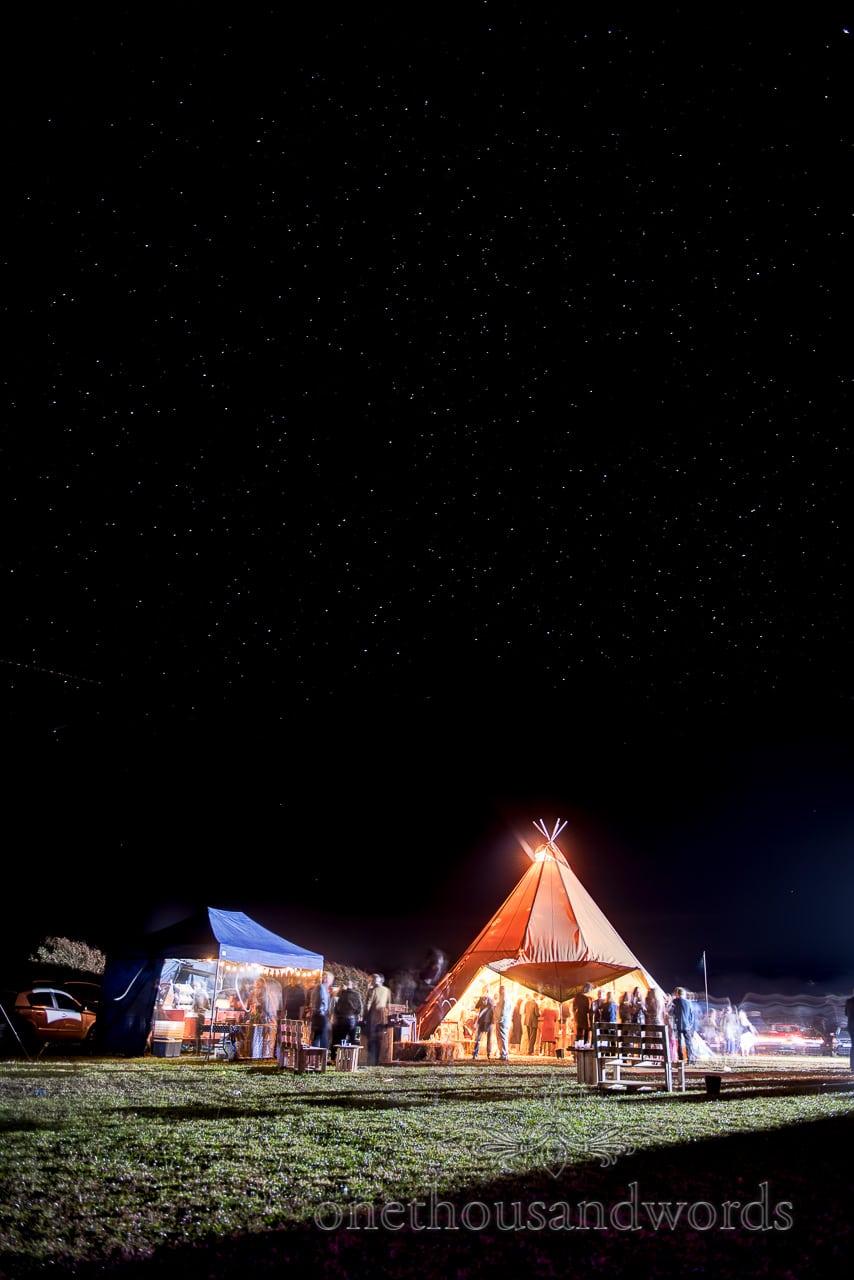 Star lit night sky with wedding tipi from Dorset Wedding Photographers Wedding