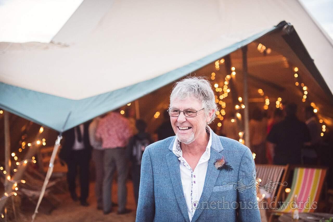 Stylish wedding guest outside wedding tipi at Dorset Wedding Photographers Wedding