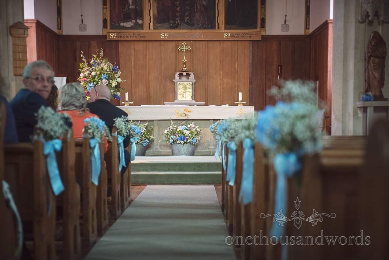 Swanage Catholic church with countryside flowers for Dorset wedding ceremony