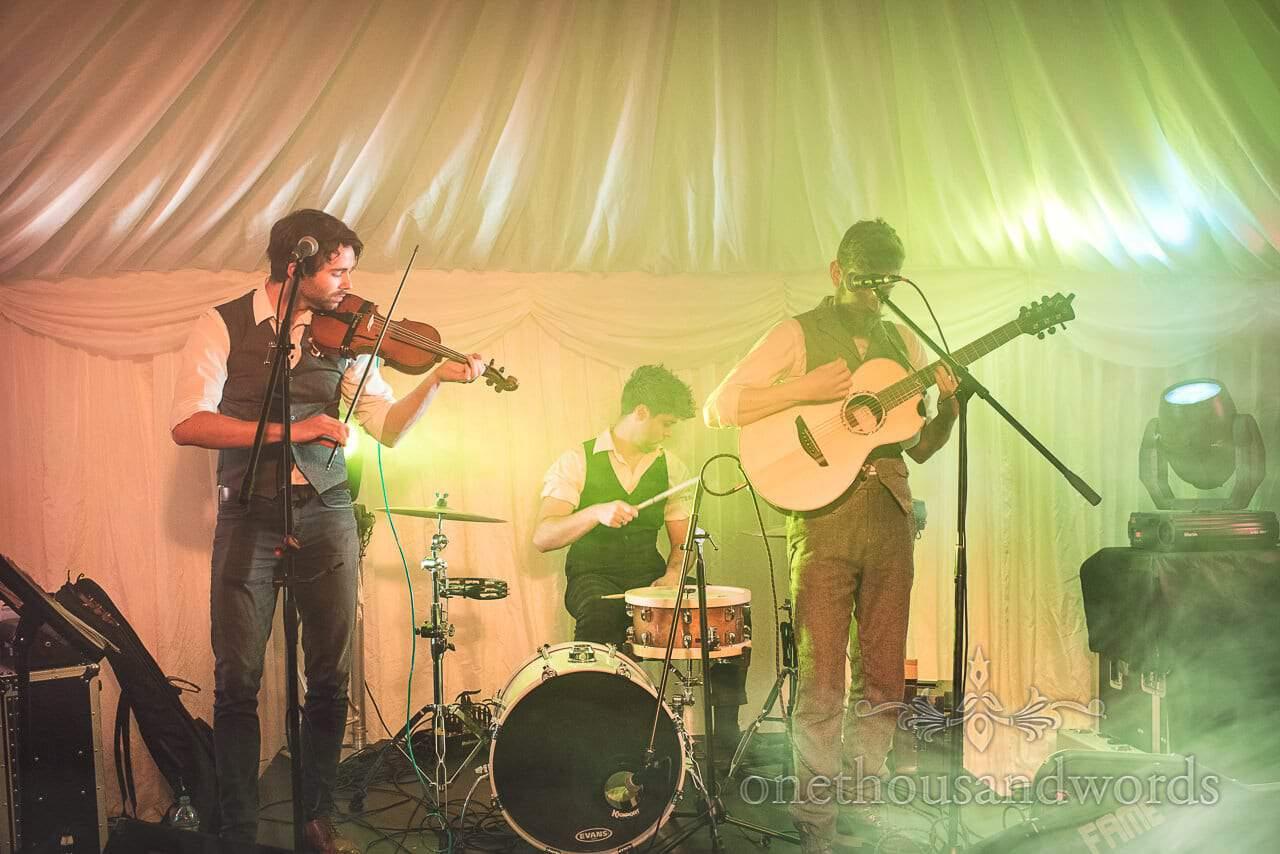Three piece band on stage at Burnbake Wedding reception