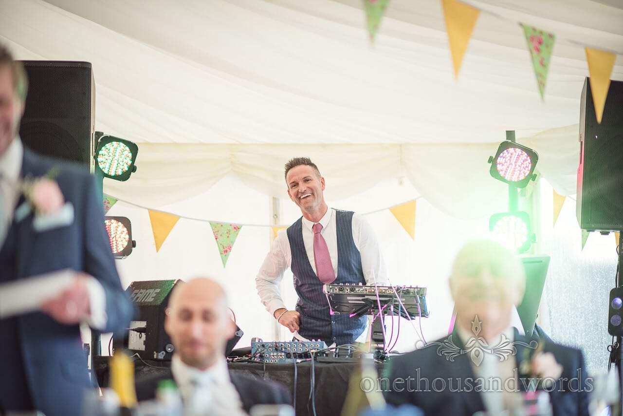 Wedding DJ laughs at best man's speech at Dorset Wedding Photographers Wedding