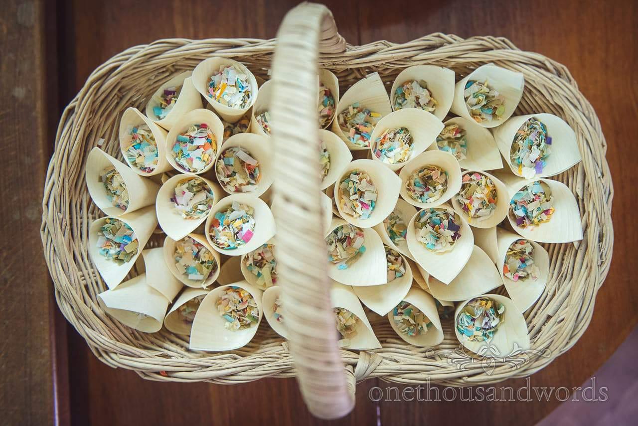 Wicker basket of confetti cones at Dorset Wedding Photographers Wedding