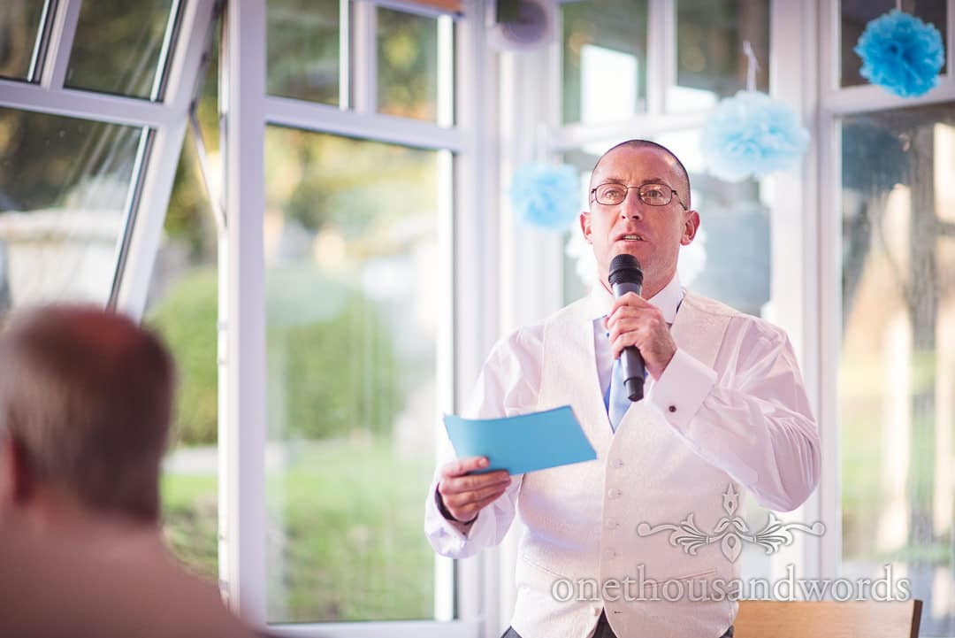 Best man makes wedding speech in conservatory at Purbeck House Hotel Wedding