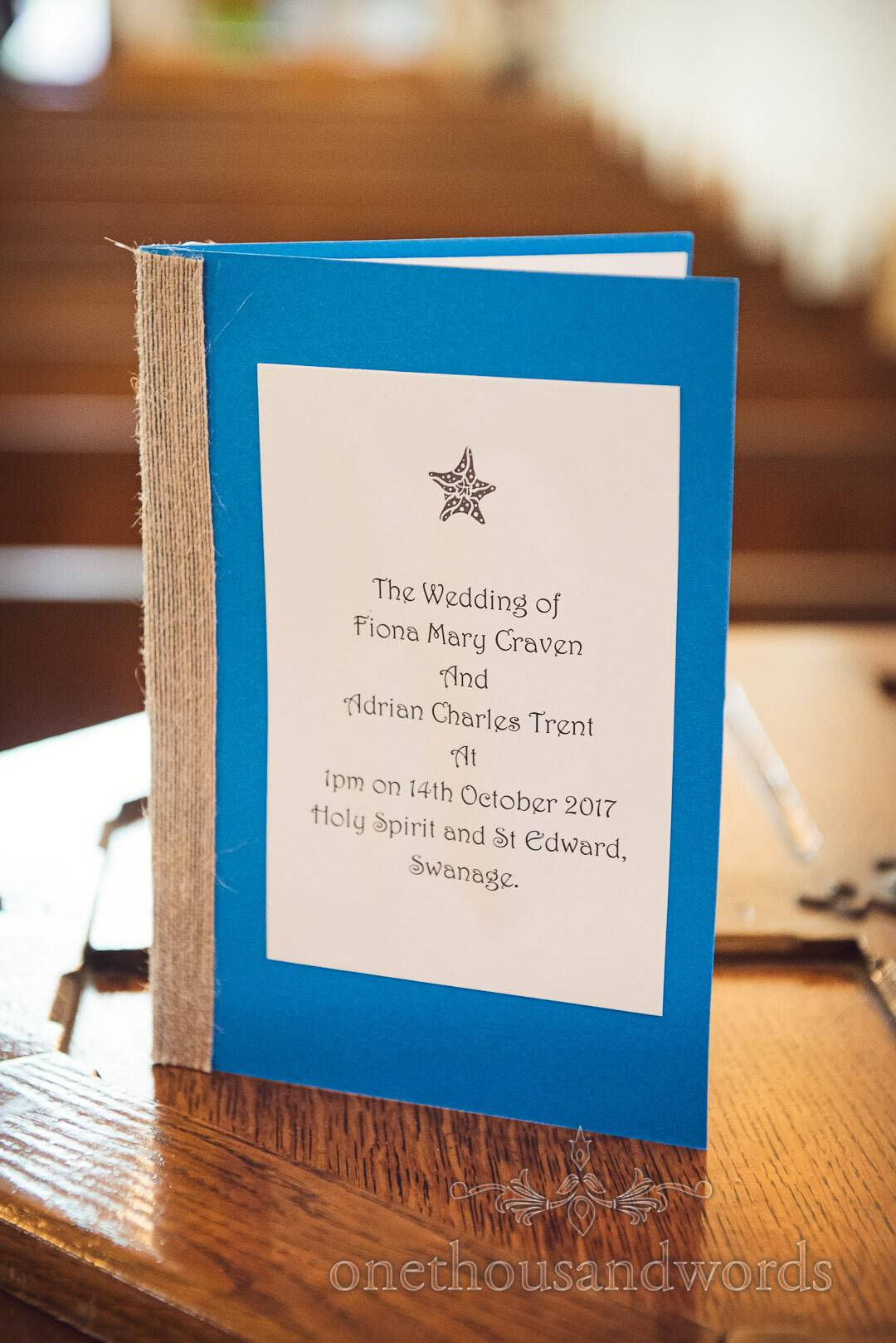 Blue and hessian sea side themed wedding order of service in church on wedding morning