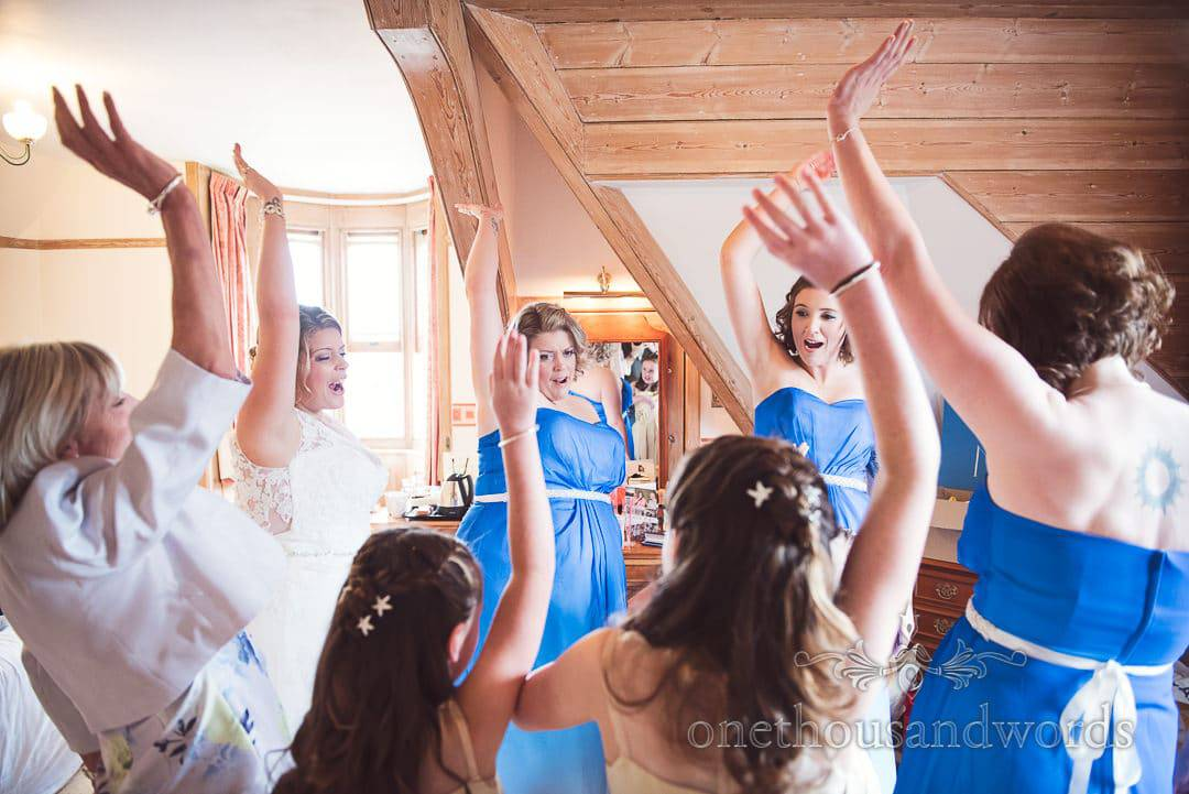 Bridal party celebrate with arms in the air wedding morning at Purbeck House Hotel